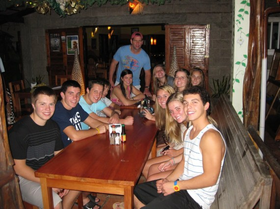 A group of young adventurers chillin' after dinner