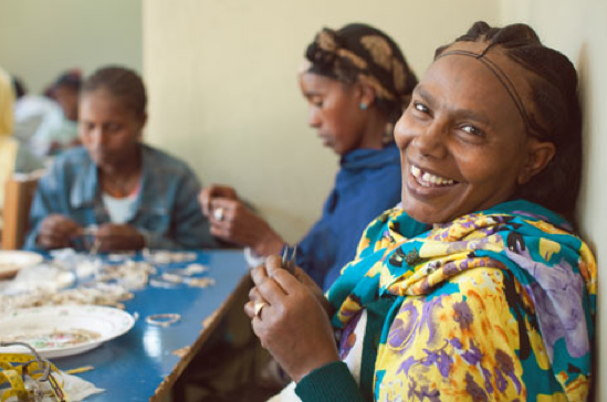Amleset of Ethiopia making jewelry for Raven & Lily